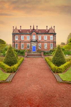 Lee Avison pathway leading through garden to a historic house