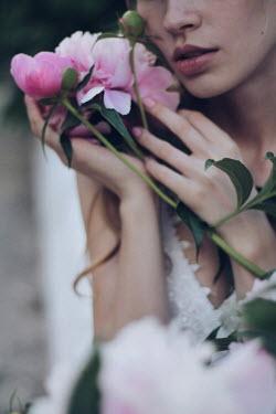 Alina Zhidovinova SERIOUS WOMAN HOLDING PINK FLOWERS Women