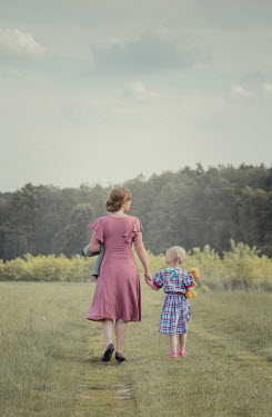 Joanna Czogala MOTHER AND DAUGHTER WALKING AND HOLDING HANDS IN COUNTRYSIDE Children