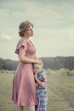 Joanna Czogala MOTHER AND DAUGHTER HUGGING IN COUNTRYSIDE Children