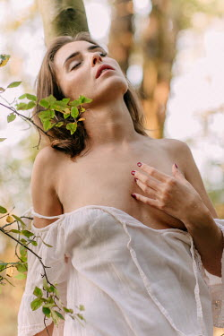 Klaudia Rataj SENSUOUS WOMAN WITH BARE BREASTS BY TREE Women