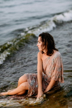 Klaudia Rataj WOMAN IN GLITTERY DRESS SITTING IN SEA Women