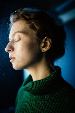 Marta Syrko WOMAN IN SWEATER WITH CLOSED EYES IN PROFILE Women