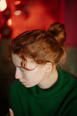 Marta Syrko SERIOUS WOMAN WITH RED HAIR IN GREEN SWEATER Women