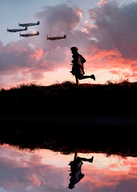 Stephen Mulcahey BOY CHASING WAR PLANES REFLECTED IN RIVER Children
