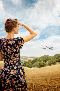 Stephen Mulcahey WOMAN IN FLORAL DRESS WATCHING WAR PLANES Women