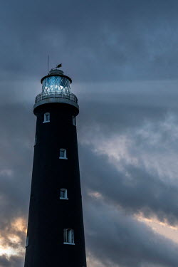 Stephen Mulcahey LIGHTHOUSE WITH STORMY SKY AT DUSK Miscellaneous Buildings