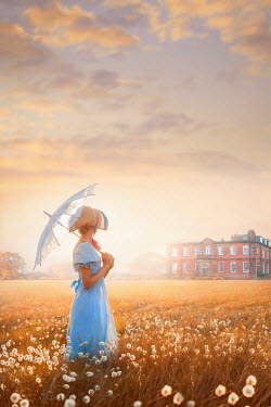 Lee Avison regency woman in a meadow looking towards a mansion house