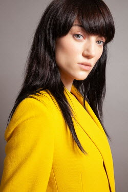 Miguel Sobreira SERIOUS WOMAN WITH DARK HAIR IN YELLOW BLAZER Women