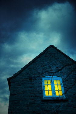 Magdalena Russocka light in window of old house at night