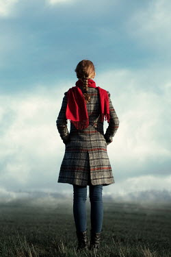 Magdalena Russocka modern woman in plaid coat standing in countryside