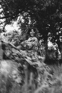 Shelley Richmond HAPPY 1970S WOMAN DANCING IN FIELD Women