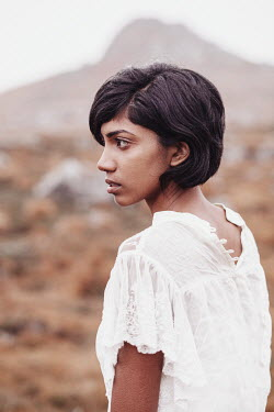 Eve North Profile of young Indian woman by mountain