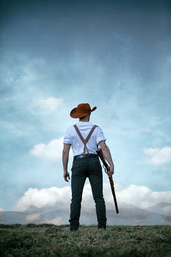 Magdalena Russocka cowboy man with rifle standing in field