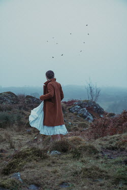 Rekha Garton GIRL IN COAT WALKING IN AUTUMN MOORLAND Women