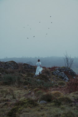 Rekha Garton WOMAN IN WHITE IN WINTRY MOORLAND Women