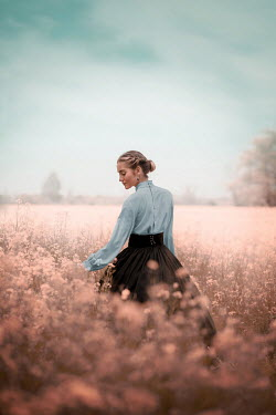 Ildiko Neer Historical woman standing in flower field