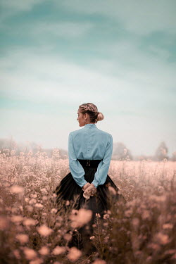 Ildiko Neer Historical woman standing in summery field Women