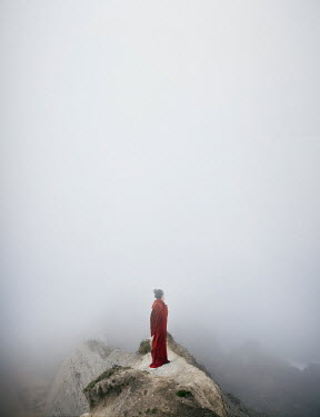 Alisa Andrei WOMAN IN RED CAPE ON FOGGY MOUNTAIN Women