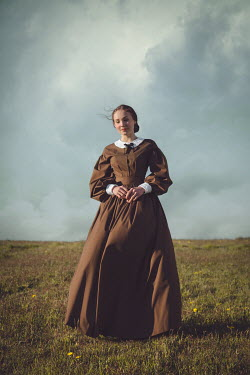 Joanna Czogala HISTORICAL WOMAN STANDING IN BREEZY FIELD Women