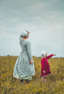 Joanna Czogala AMISH MOTHER AND CHILD SEARCHING IN FIELD Children