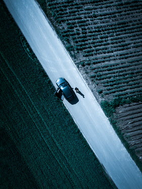 Magdalena Russocka aerial view of walking man and car on road
