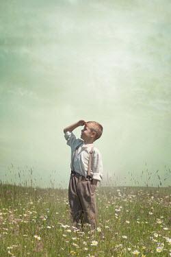 Joanna Czogala LITTLE BOY IN BRACES WATCHING IN FIELD Children