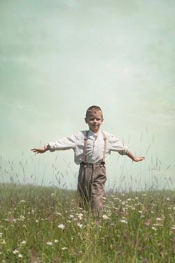 Joanna Czogala LITTLE BOY IN BRACES PLAYING IN FIELD Children