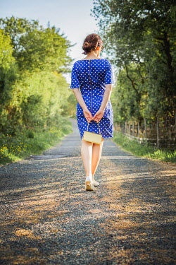 Marie Carr WOMAN IN POLKA DOT DRESS ON COUNTRY ROAD Women
