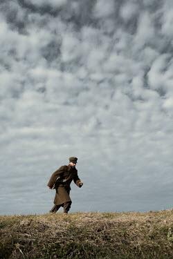 Magdalena Russocka soldier running on hill