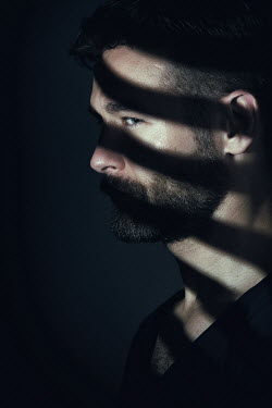 Magdalena Russocka close up of man with shadow of blinds on face