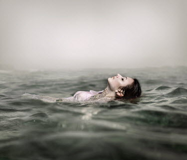 Alisa Andrei WOMAN FLOATING IN FOGGY OCEAN Women