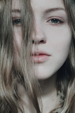 Alina Zhidovinova SERIOUS BLONDE GIRL WITH HAIR COVERING FACE Women