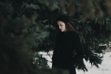 Alina Zhidovinova SAD BRUNETTE GIRL BY TREE WITH SNOW Women