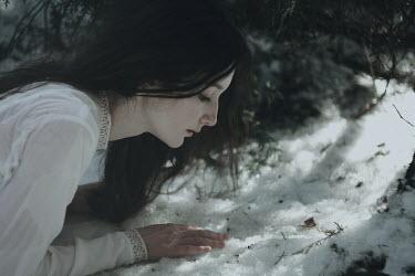 Alina Zhidovinova GIRL LYING TOUCHING SNOW ON GROUND Women