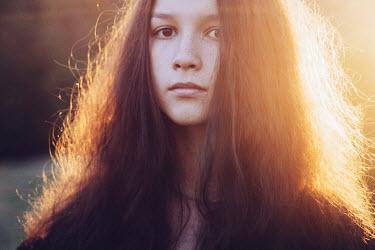 Alina Zhidovinova GIRL WITH LONG DARK HAIR IN SUNLIGHT OUTDOORS Children