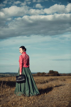 Magdalena Russocka historical woman holding bag standing in countryside