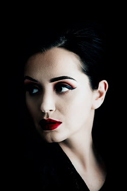 Nic Skerten SERIOUS WOMAN WITH DARK HAIR AND RED LIPS Women