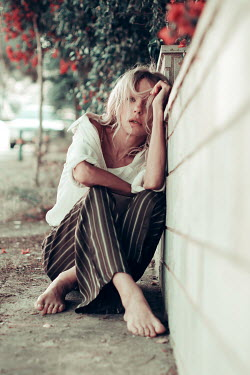 Irene Lamprakou SAD BAREFOOT BLONDE WOMAN SITTING ON PAVEMENT Women