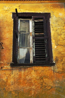 Irene Lamprakou WEATHERED EXTERIOR OF OLD HOUSE WITH SHUTTERS Building Detail