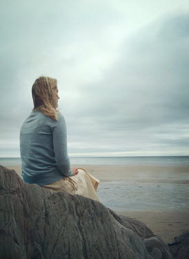 Mark Owen BLONDE WOMAN SITTING ON ROCK WATCHING SEA Women