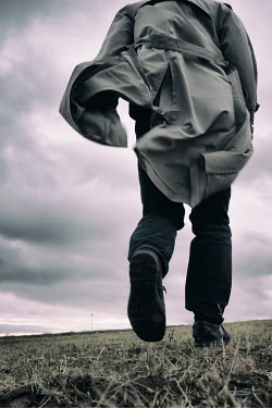 Tim Robinson Young man in gray coat running in field