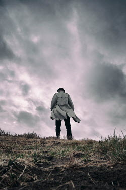 Tim Robinson Young man in gray coat standing in field