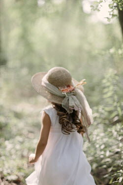 Nikaa Girl in straw hat in forest