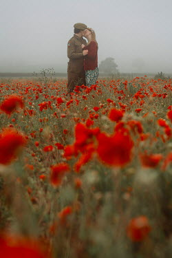 Shelley Richmond Soldier and young woman kissing in poppy field