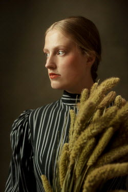 Ysbrand Cosijn Young woman with cattail plants