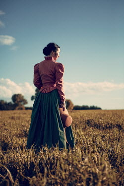 Magdalena Russocka historical woman with bonnet standing in field