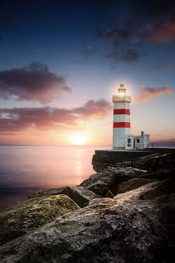 Evelina Kremsdorf LIGHTHOUSE WITH SEA AND ROCKS AT SUNSET Miscellaneous Buildings