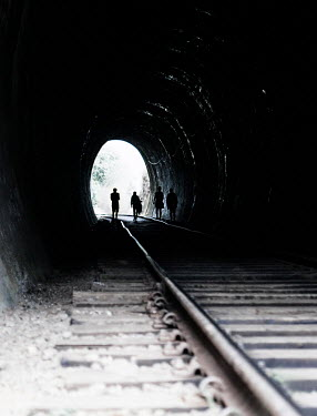 Nikaa SILHOUETTED GROUP WALKING IN RAILWAY TUNNEL Groups/Crowds