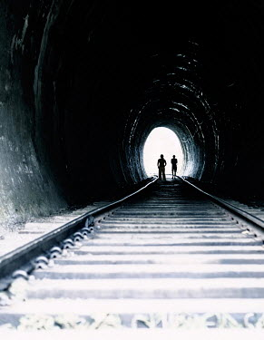 Nikaa COUPLE STANDING IN dark RAILWAY TUNNEL Couples